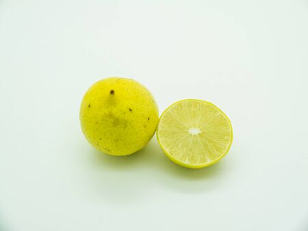 extensively: Thai limes (Manao) are green and yellow isolated on white background, the size of a golf ball and very sour. They are used extensively to provide tartness to Thai salads.