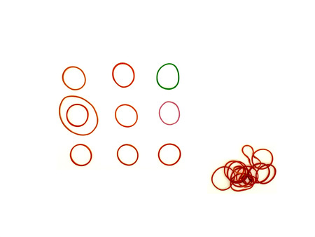 heap up: red and green elastic band roll arrange in consecutive order and heap up