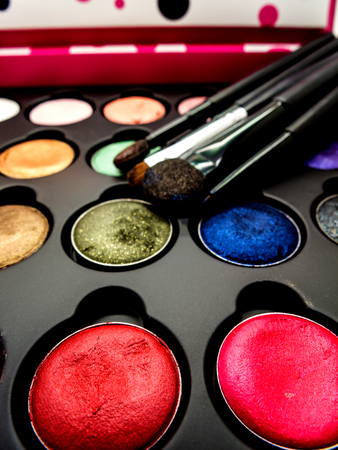 eye liner: used multi-color cosmetic cushion, eye shadow, eye liner brusher, lip, highlight, shading selective focus Stock Photo