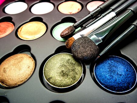 to shading: used multi-color cosmetic cushion, eye shadow, eye liner brusher, lip, highlight, shading selective focus Stock Photo