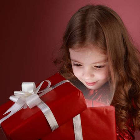 litle girl open red gift box photo