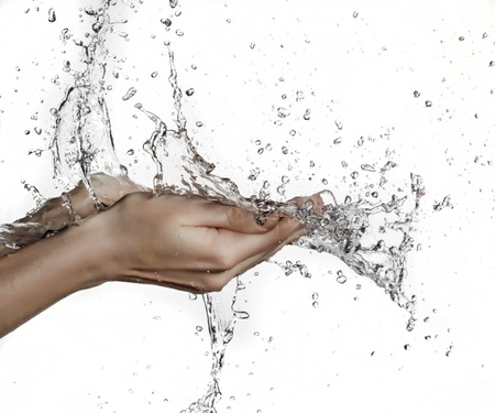washing up: woman hand in water splash