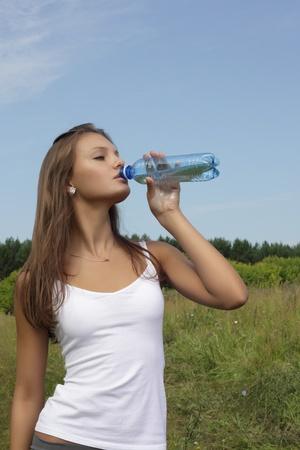 beautiful girl drink water photo