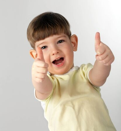 boy show thumb up symbol photo