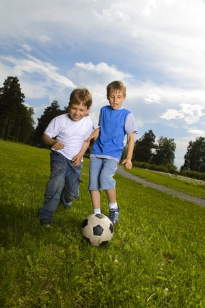 two happy boy play in soccer Stock Photo - 9776355