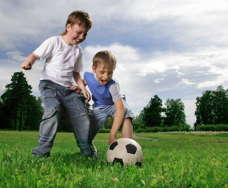 boys soccer: two happy boy play in soccer