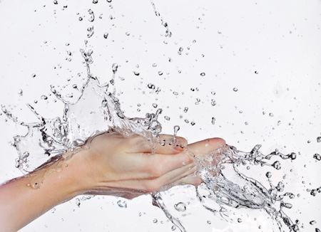 bodies of water: woman hand in water stream Stock Photo