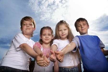 happy child team outdoors photo
