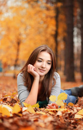 beauty girl in autumn park photo