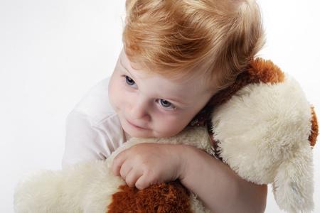 babay embrace toy dog photo