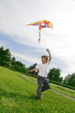 flying kite: happy boy with kite Stock Photo