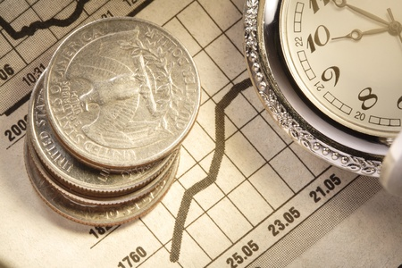 coin and clock on chart photo