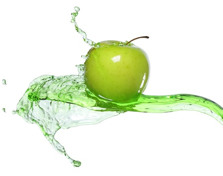 green apple in juice stream Stock Photo