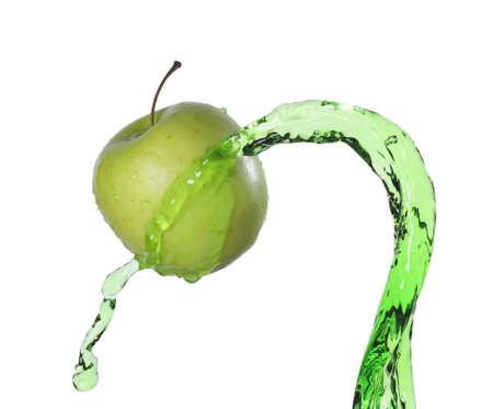 green apple in juice stream photo
