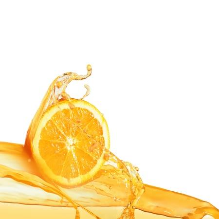 orange slice in juice stream photo
