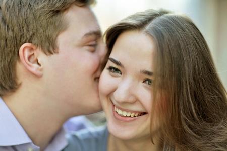 secret love: couple whispering Stock Photo