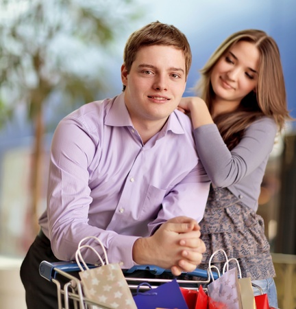 young couple shopping together photo