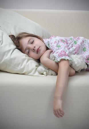 girl sleep on sofa photo