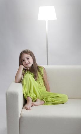 beauty girl on sofa Stock Photo - 10376699