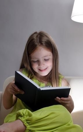 beauty girl read book on sofa Stock Photo - 10376712