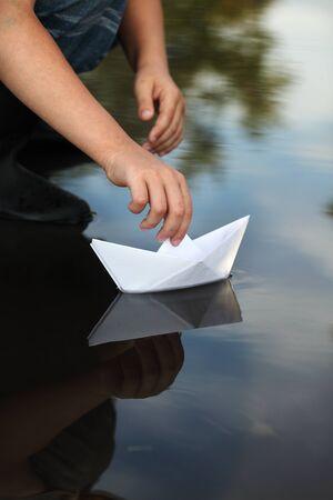 paper boat: paper ship in children hand Stock Photo