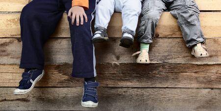 three boy on wood deck photo