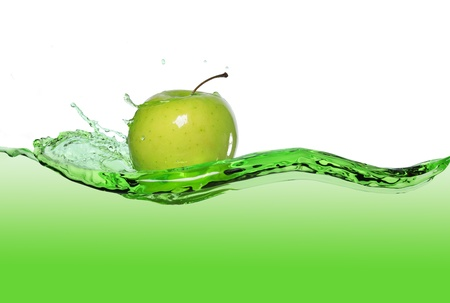 fruit drop: green apple in juice stream Stock Photo