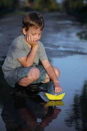 navigate: paper ship in children hand Stock Photo