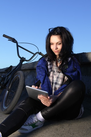beauty girl with laptop pc outdoors photo