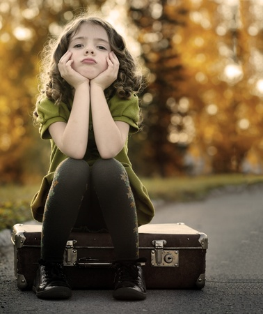 resentful girl on suitcase Stock Photo - 10676635