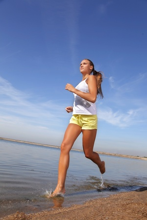 beauty girl run on beach photo