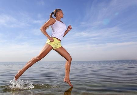 jogging in nature: beauty girl run on beach