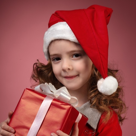 litle girl with red gift box photo