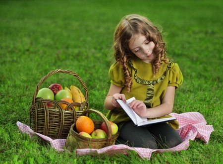 one story: beauty girl  read book outdoors Stock Photo