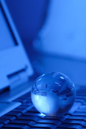 glass globe on keyboard photo