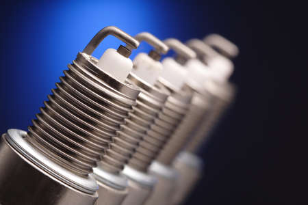 car engine: spark plug on blue background