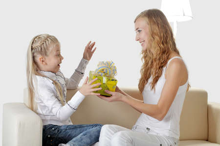 girl receives a gift from Mom Stock Photo - 11368077