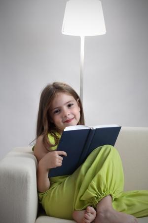 bibliophile: beauty girl read book on sofa Stock Photo
