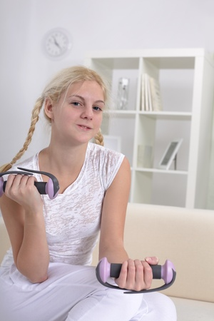 only the biceps: beauty girl with dumbbells Stock Photo