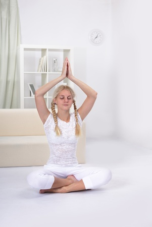beauty girl in lotus pose indoors Stock Photo - 11445667