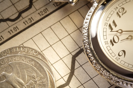 forex: coin and clock on chart Stock Photo