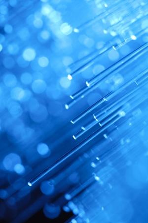 information science:  optics fibers on blue background