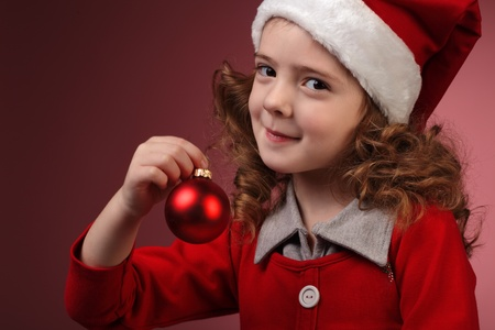 little girl with christmass ball photo