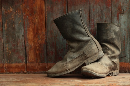 work boots: grunge boots on wood background Stock Photo