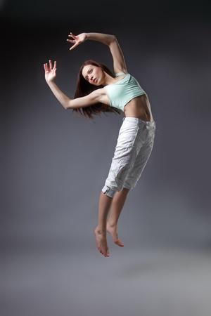 beauty girl dance on grey background photo