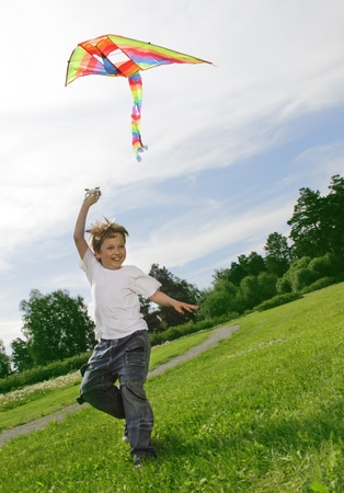 flying a kite: happy boy with kite Stock Photo