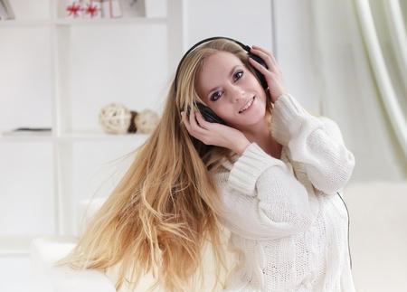 beauty girl listen music in headphones photo