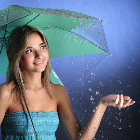 1 woman only: happy girl in the rain Stock Photo