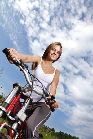 beauty girl on bike in summer day photo