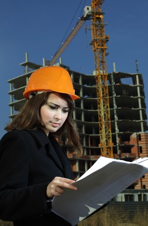beautiful architect in a construction site photo